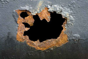 Pitting Corrosion - the origin of this hole in the pipe.